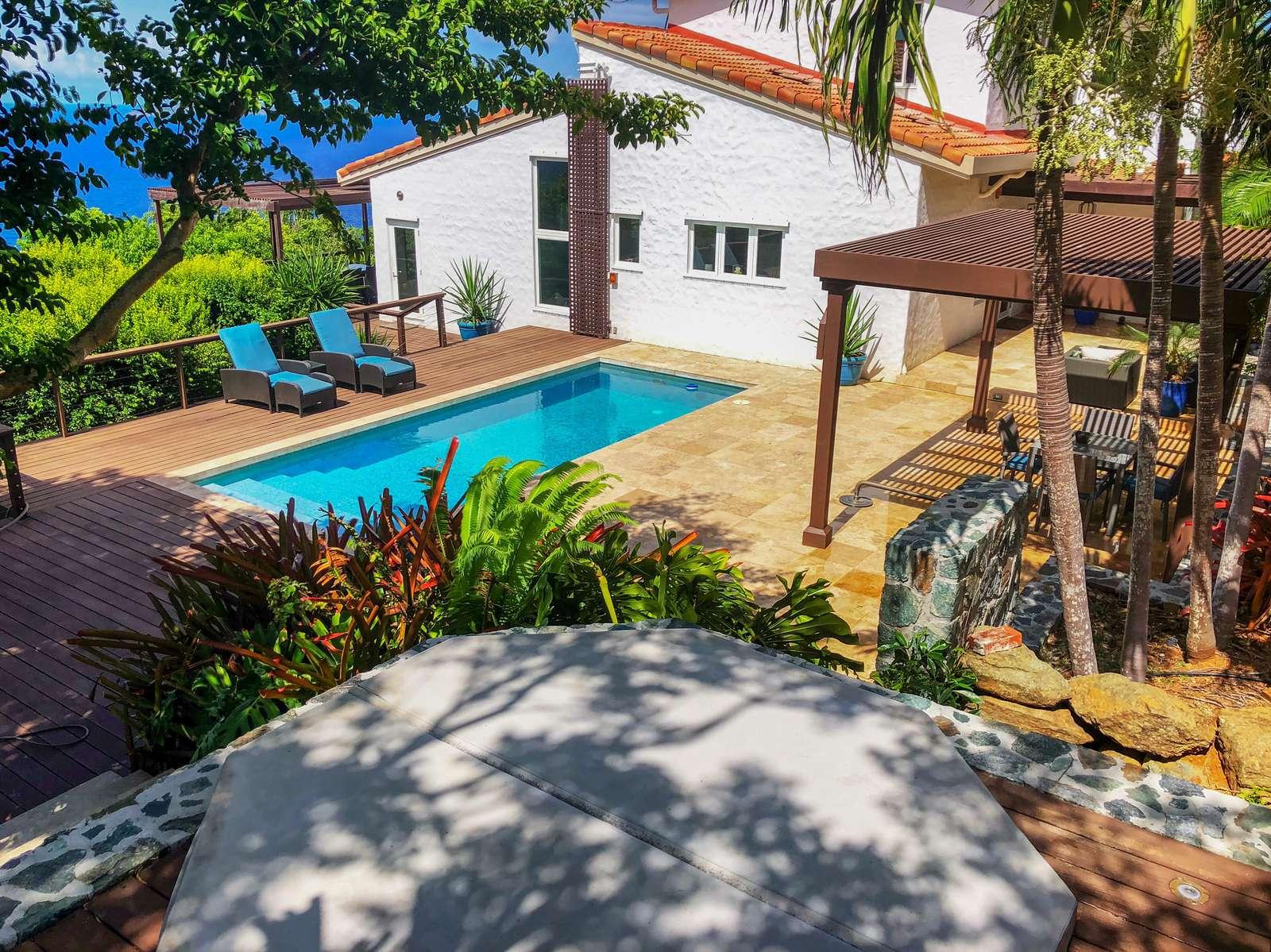 Spacious pool deck and hot tub