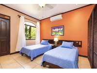 Guest bedrooms, 2 twin beds, shared bathroom thumb
