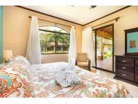 Master bedroom, king bed, private bathroom thumb