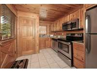 Fully Stocked Kitchen with Washer/Dryer Unit thumb