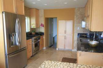 Ocean Sun kitchen, complete with professional stove and refrigerator. thumb