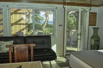 COCO BUNGALOW full sofa sleeper & view to ocean thumb
