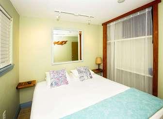 PAPAYA 3: bedroom #1 of 3, Cal. King bedding. thumb