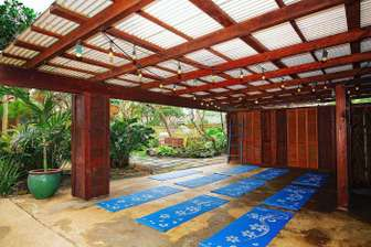 Patio common space can be arranged for many functions including a yoga space. thumb