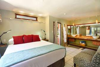 OCEAN BREEZE SUITE bedroom King bed & wall to wall vanity. thumb