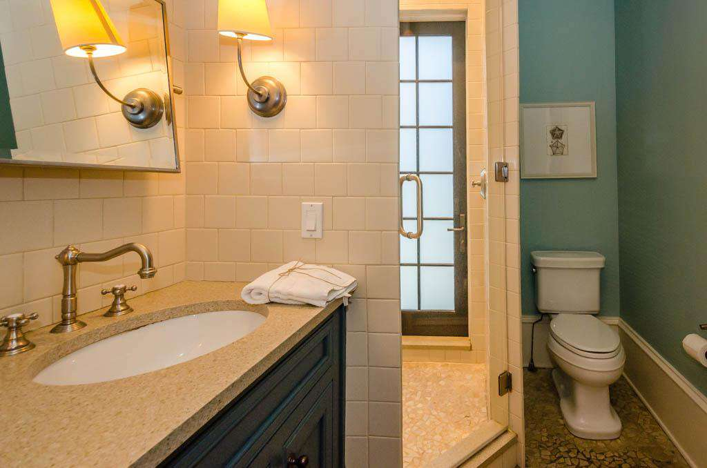 1st Floor Full Bathroom: Private Entrance from Pool Area Directly into an Indoor Shower