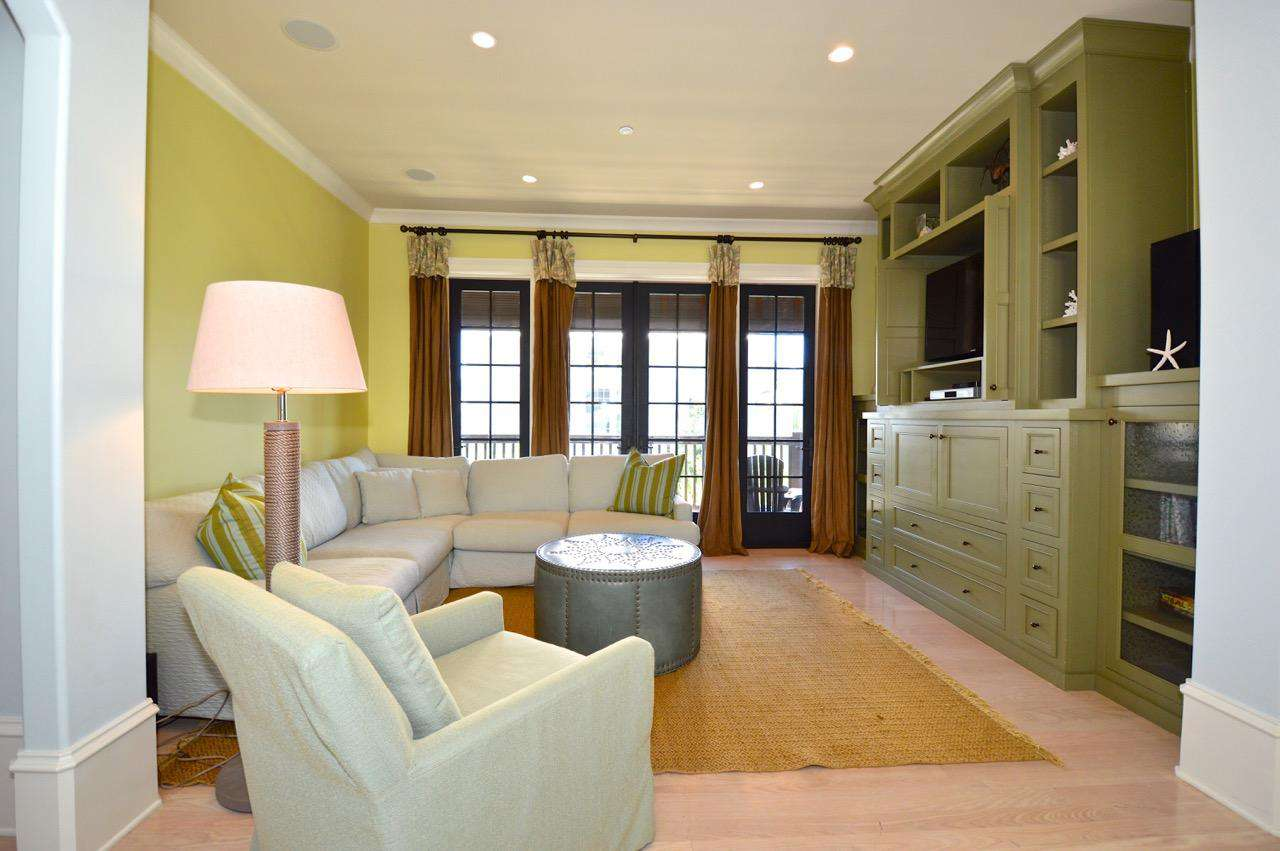 2nd Floor Entertainment/Lounge Area: Spacious and Comfortable Entertainment Area with TV and Access to Covered Balcony