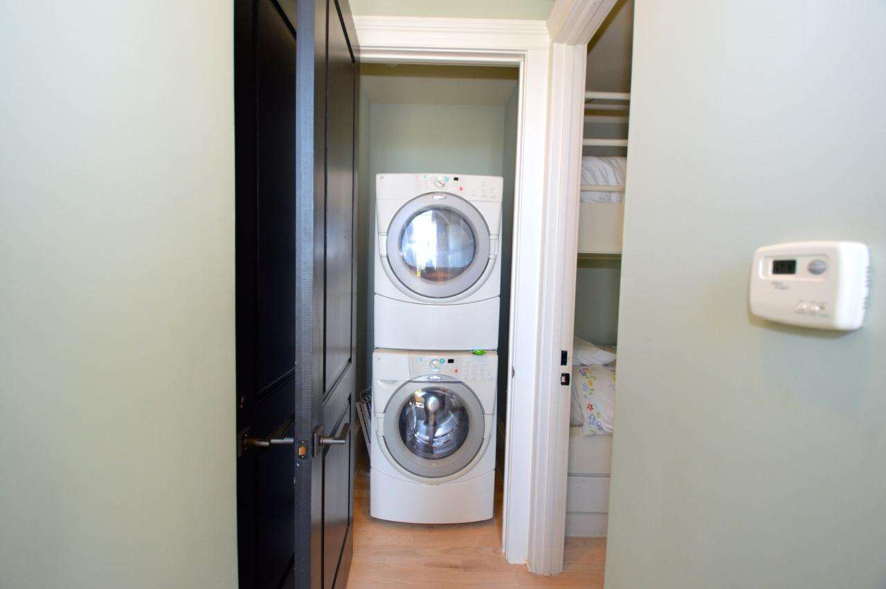 Full size washer and dryer located in the hall closet