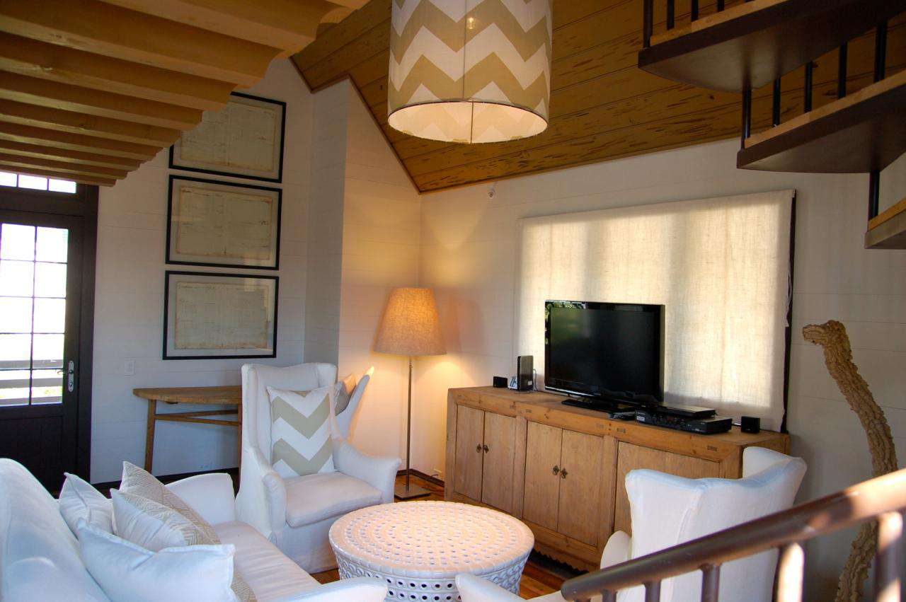 The main room combines a comfortable entertainment/TV area and a full kitchen