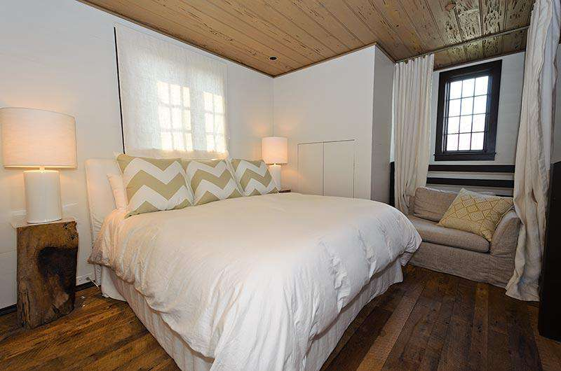 Just up the spiral staircase, you will enter the master bedroom featuring a plush King Bed