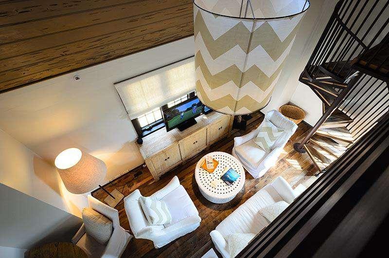 The exquisite bedroom opens to the living area below