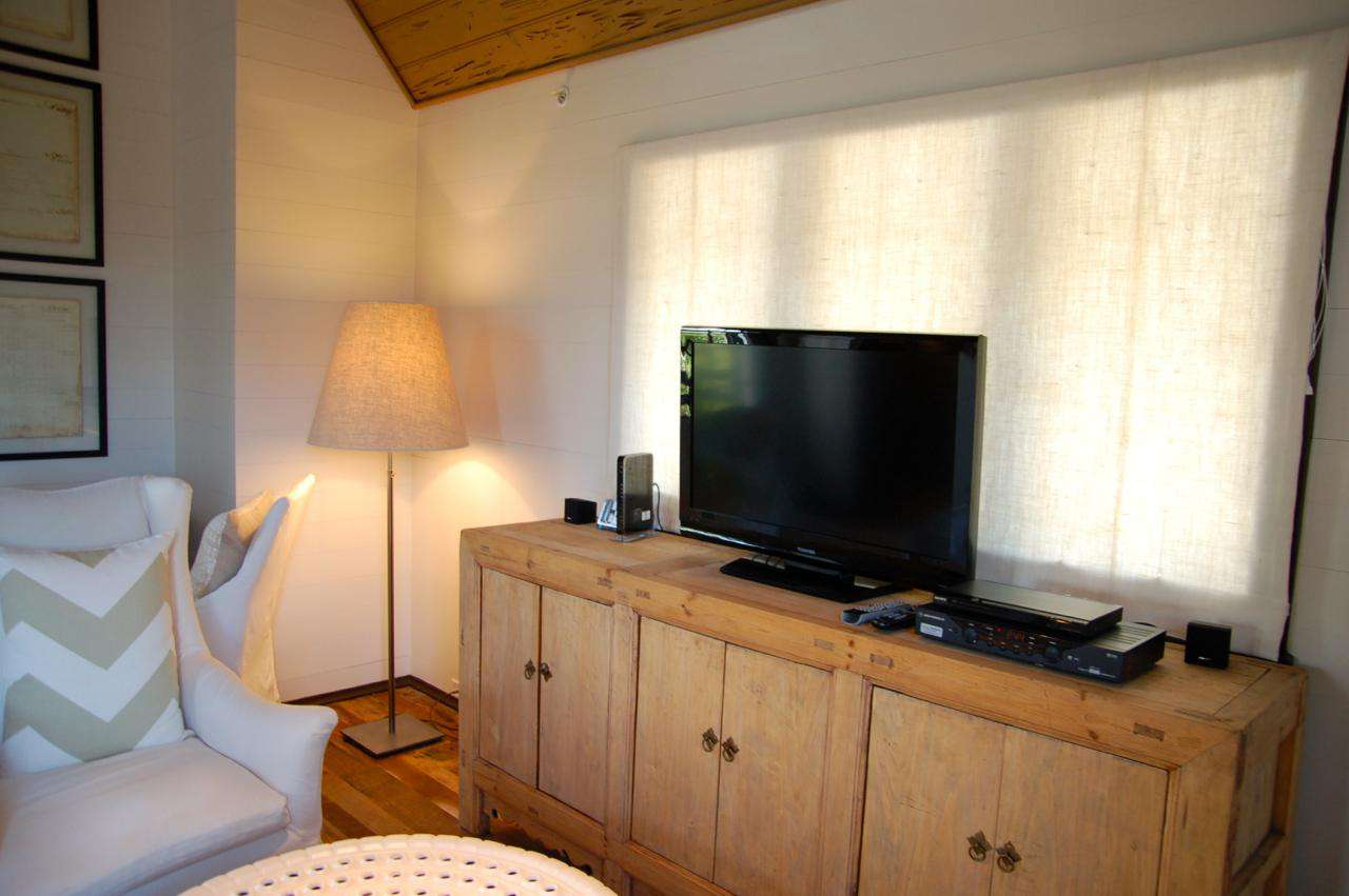 Flat-screened TV, DVD Player and WiFi Provided