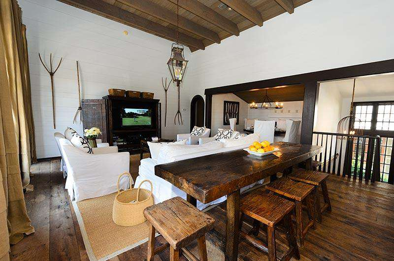Second floor is an open and alluring space with Pecky Cypress doors and unfinished antique oak floors