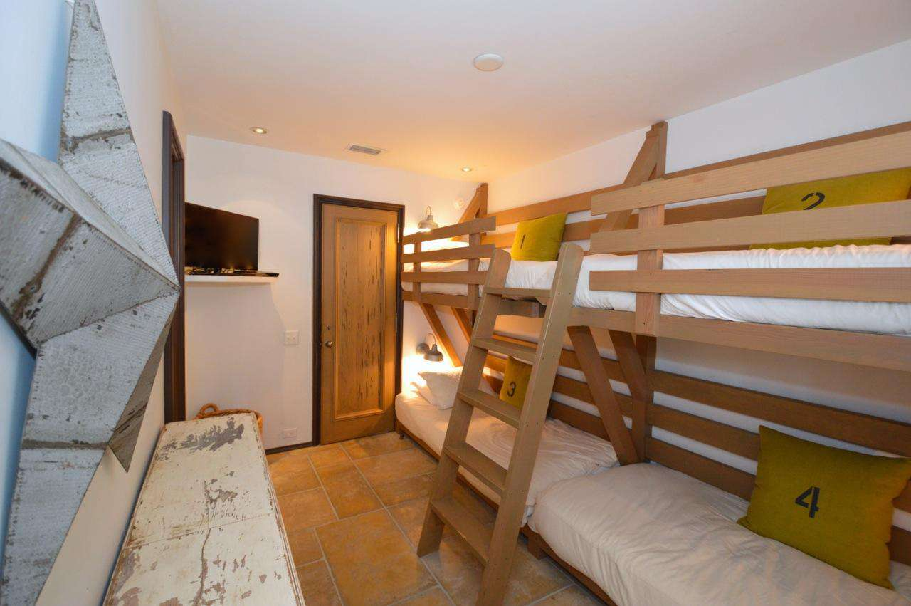 Fun children's room with fluffy custom bunks to sleep 4 as well as a private bath