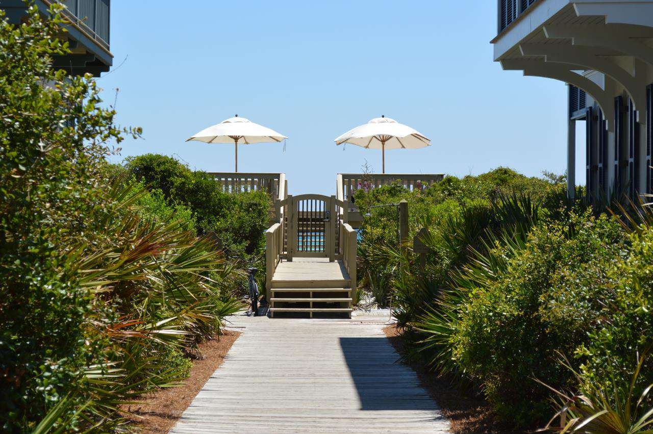 You are only steps down a wooden boardwalk to the magnificent sugar white sands and emerald waters