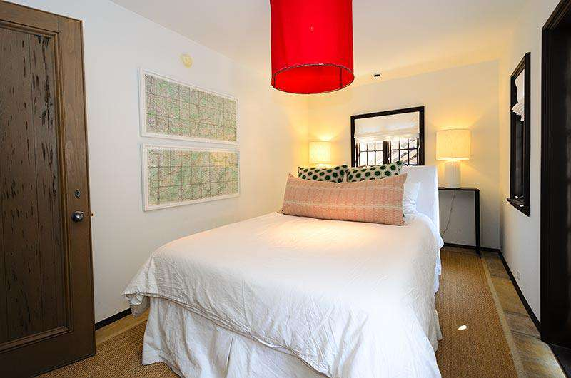 First floor Queen guest room with TV, private bath and access to lovely courtyard with flowing fountain