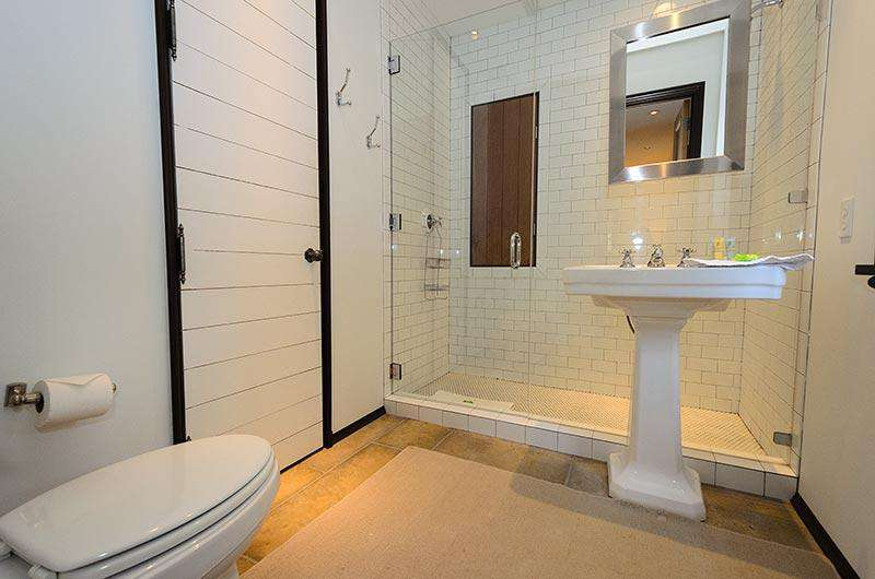 Private bath off queen guest room with large glass enclosed shower