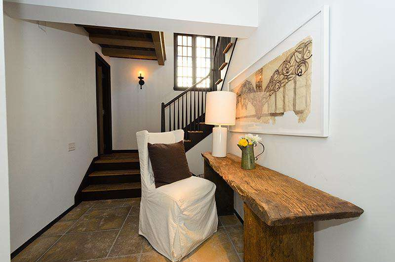 Entryway from loggia/pool area. Charming powder room located halfway up the staircase that serves both the pool and the 2nd floor