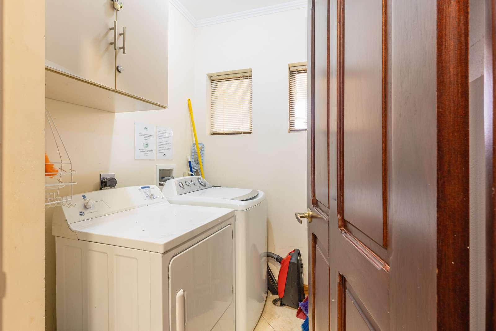 Laundry room inside condo