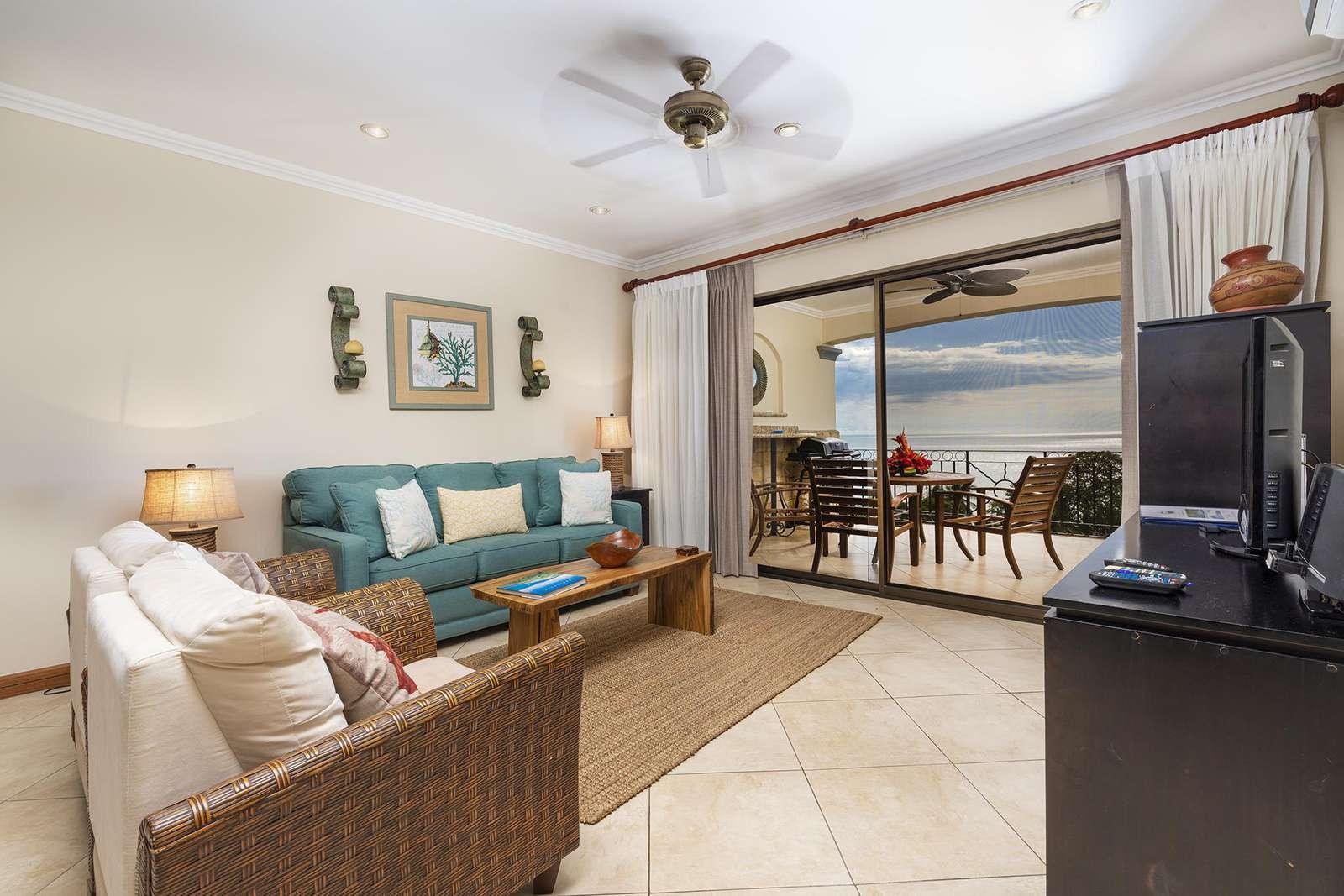 Main living area, TV, sleeper sofa, access to balcony, amazing ocean views