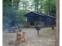 Back view showing picnic area and back porch thumb