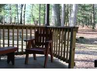Back porch with wood porch furniture. thumb