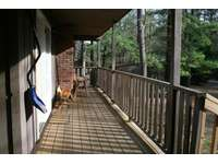Front porch of Hemlock Haven Cabin that enters into the Kitchen. thumb