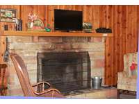 Living room fireplace with tv thumb