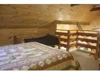 Loft Bedroom with Queen bed and 2 single beds. thumb