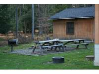Picnic area at Sunburst Locust Cabin and the Annex. Charcoal Grill, Firepit, picnic tables.  thumb