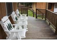 Large covered deck on Sunburst Locust Cabin. thumb