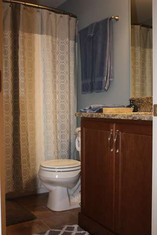 Lower level bath with washer and dryer