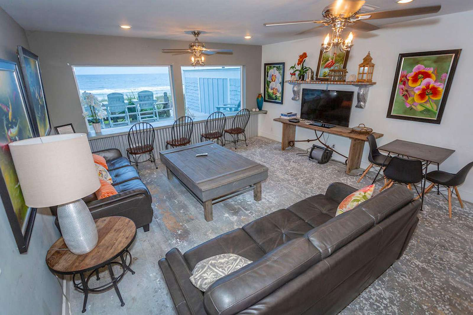 family room with 2 large sofas, flat screen, bar table with 4 chairs, card table with 4 chairs,