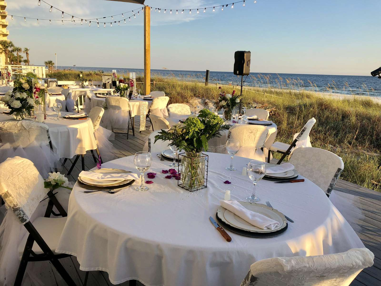 Beautiful wedding reception for 50 people on back deck -overlooking the gulf