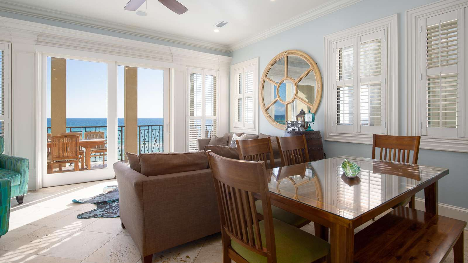 The open living room, dining room, and kitchen look out to the emerald waters!