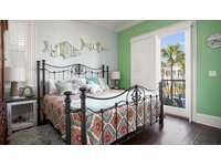 The 3rd bedroom features a king sized bed, private balcony, and full bathroom. thumb