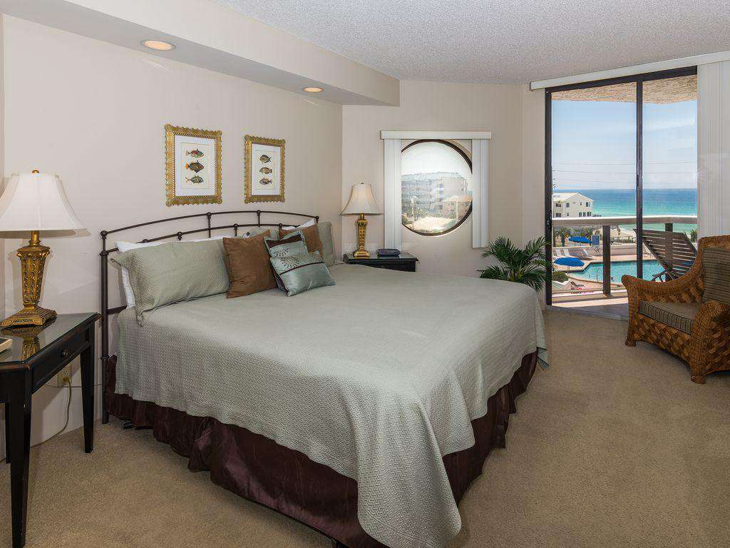 The master bedroom features a king sized bed, en suite bathroom, and a fabulous view of the water!