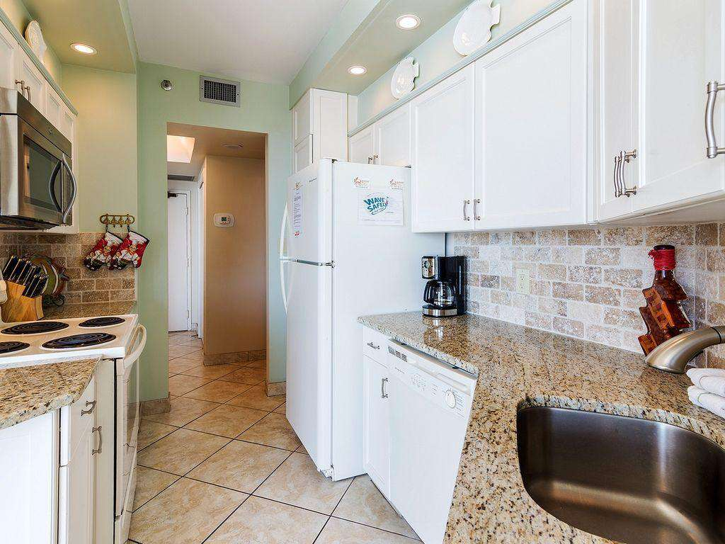 This wonderful kitchen is bright and open to the beautiful views of the Gulf!