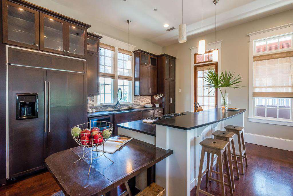 Gourmet Kitchen with Extra Large Refrigerator and Seating Space for 3 at Small Table at End of Island