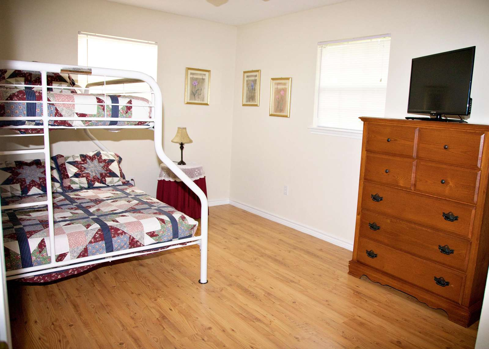 The third bedroom is a twin over full bunk with a flat screen television and basic cable.