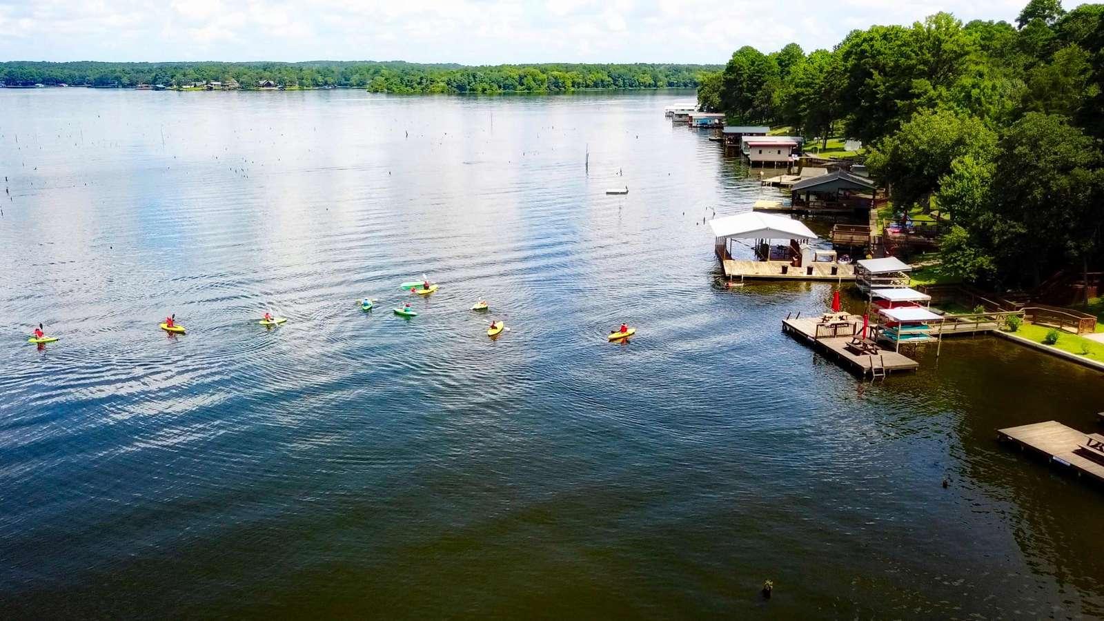 Guests enjoying the kayaks and lake.