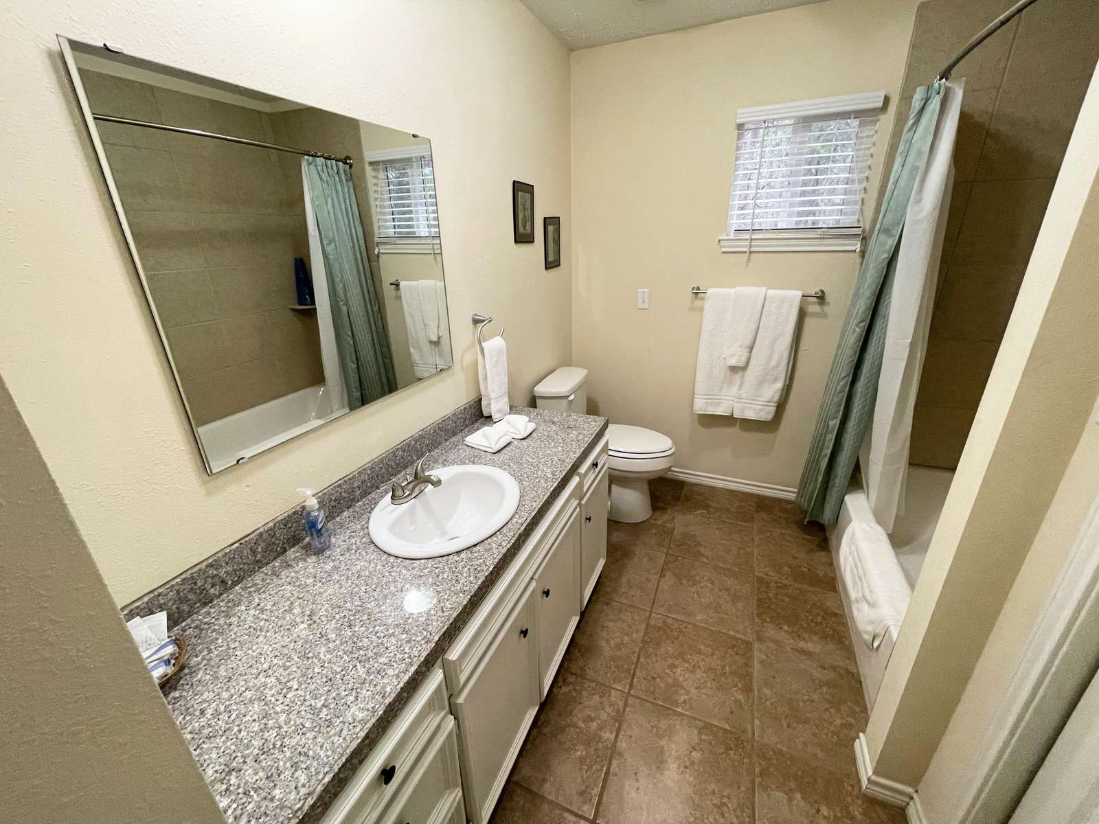The Master Bathroom with tiled tub/shower unit.