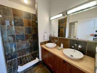 Second bedroom bathroom with a large slate shower thumb