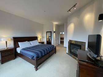 Master Bedroom with a king bed, gas fireplace and Pacific Ocean views! thumb
