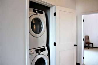Private in room front load washer and dryer thumb