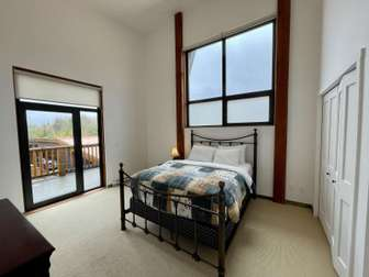 Second bedroom with a queen bed and deck thumb