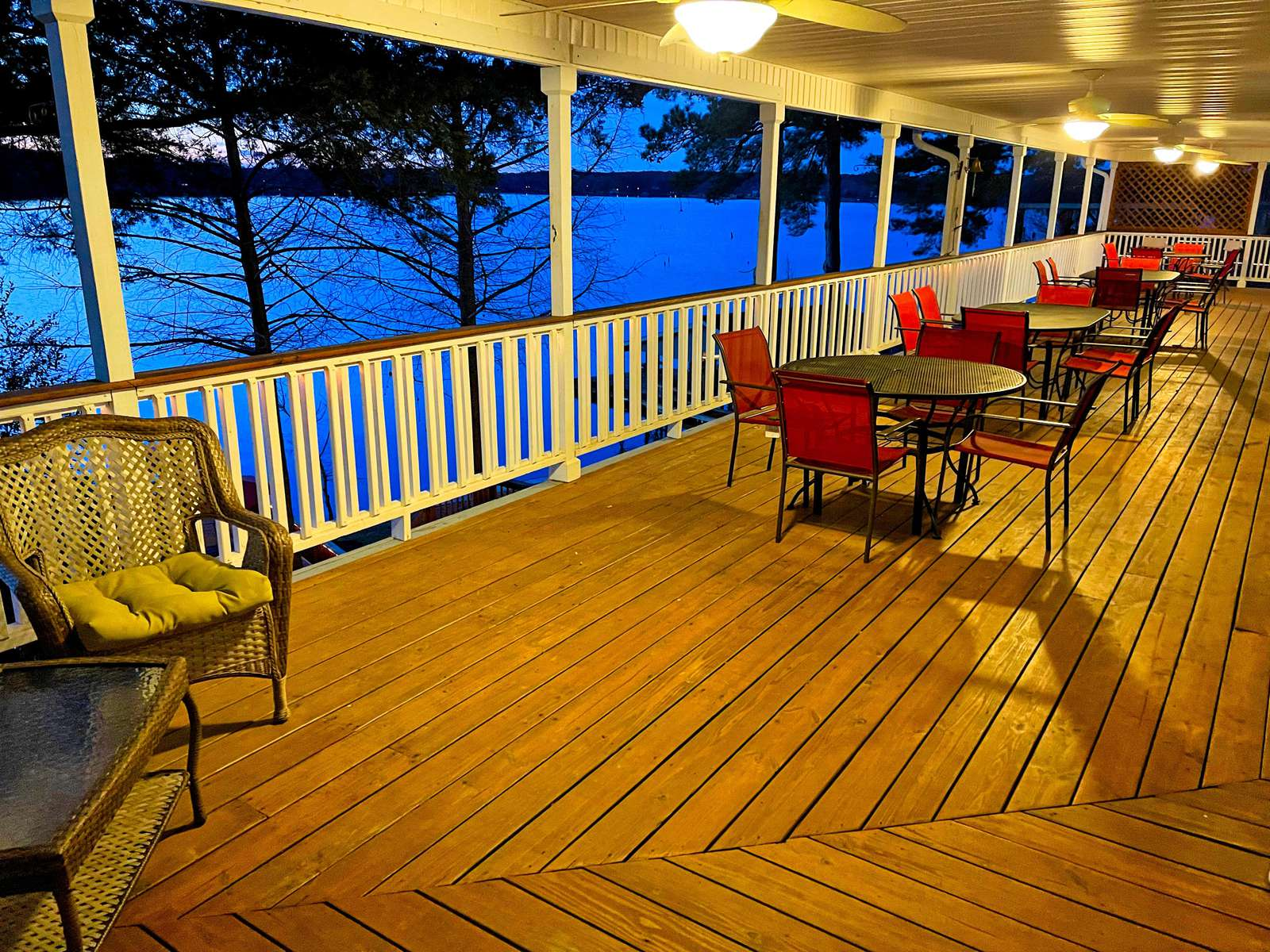 The massive porch is a great place for  family and friends to gather for games or a meal.