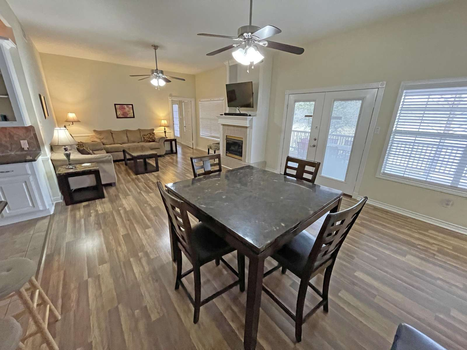 The roomy living area with adjacent game/meal table.
