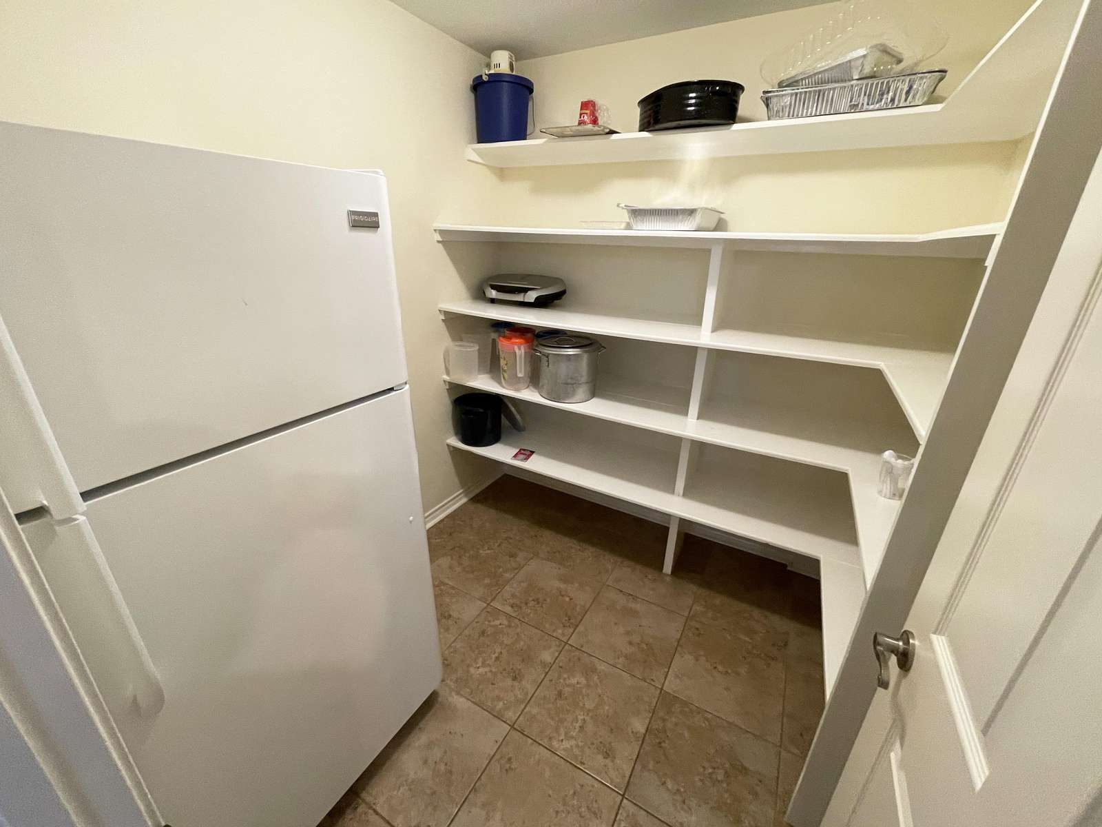 A closer look at the large pantry area that's perfect for storing all your food and drinks.