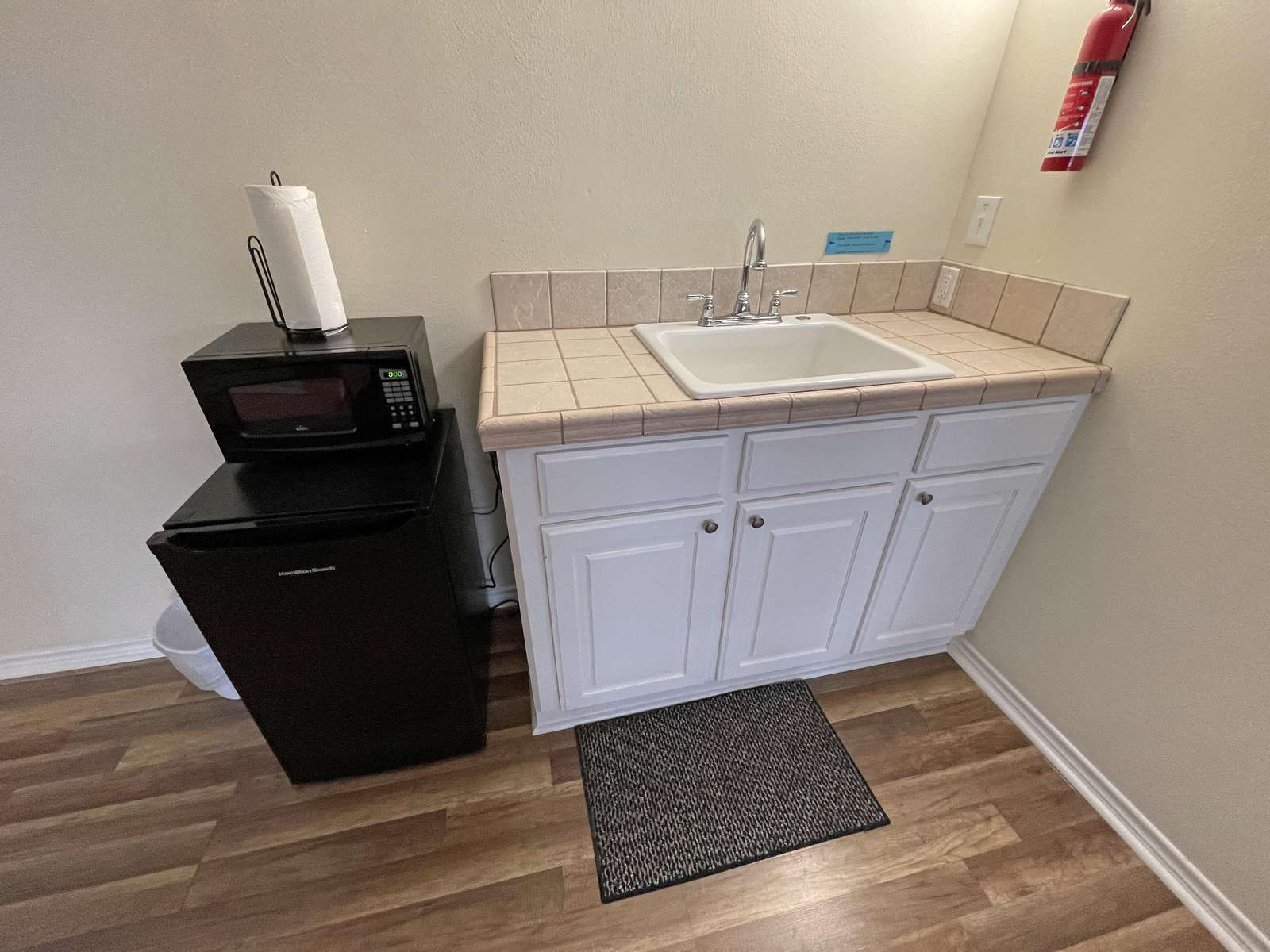 The Small Fridge and microwave are great for the kids to use while enjoying the upstairs gameroom.